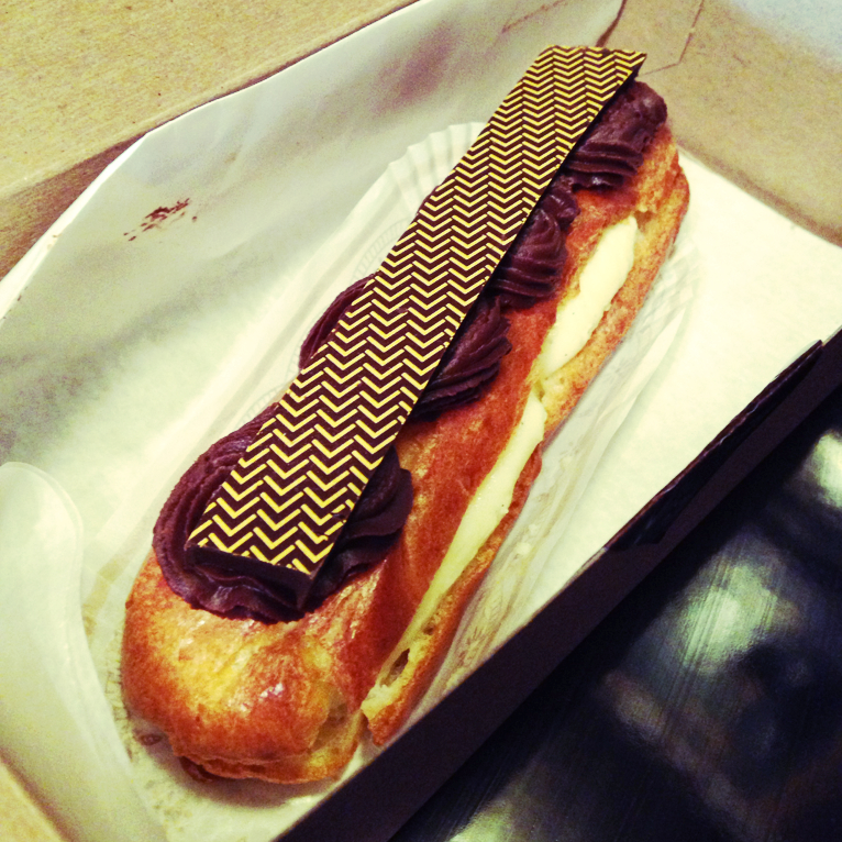 Eclair with  bean filling and whipped chocolate ganache topping.