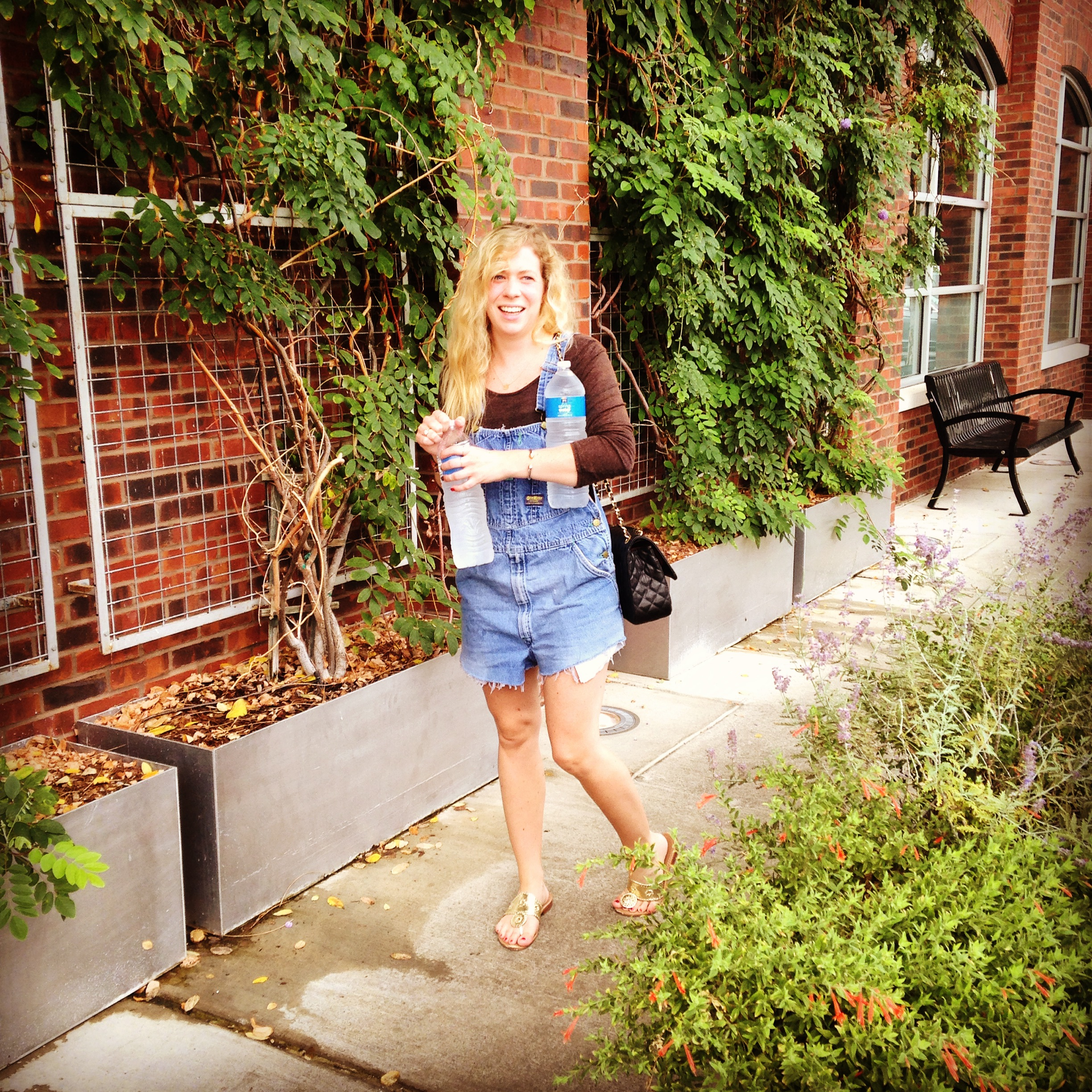 Trying to revive myself at Whole Foods with two extreme bottles of water. Wearing my grandfather's overalls and an Urban Outfitters long sleeve crop (and looking less than fabulous).