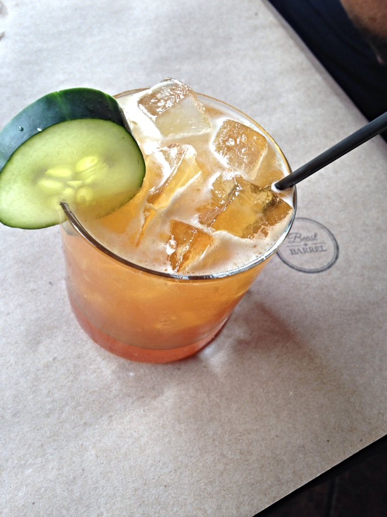 A refreshing Pimm's Cup - made from Pimms, fresh squeezed lemon juice, seltzer, cucumber, and apple.