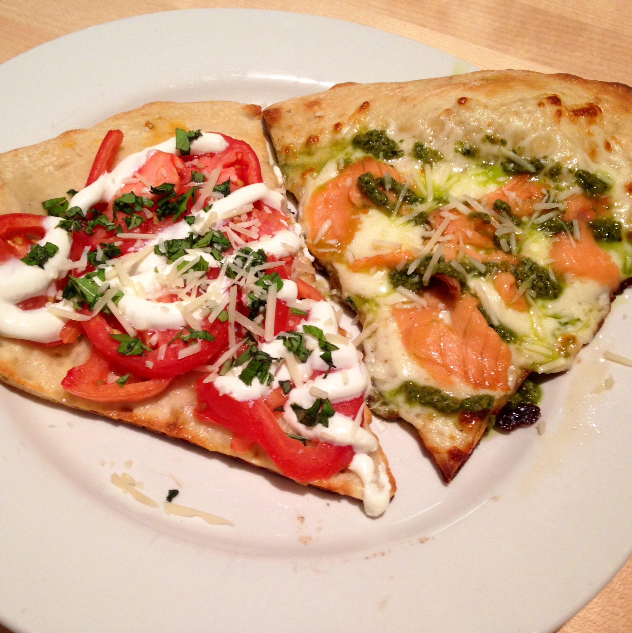 My two slices -  On the left, goat cheese white pizza with Roma tomatoes and basil. On the right - Smoked salmon white pizza with pesto. They both pieces were so flavorful! Loved them!