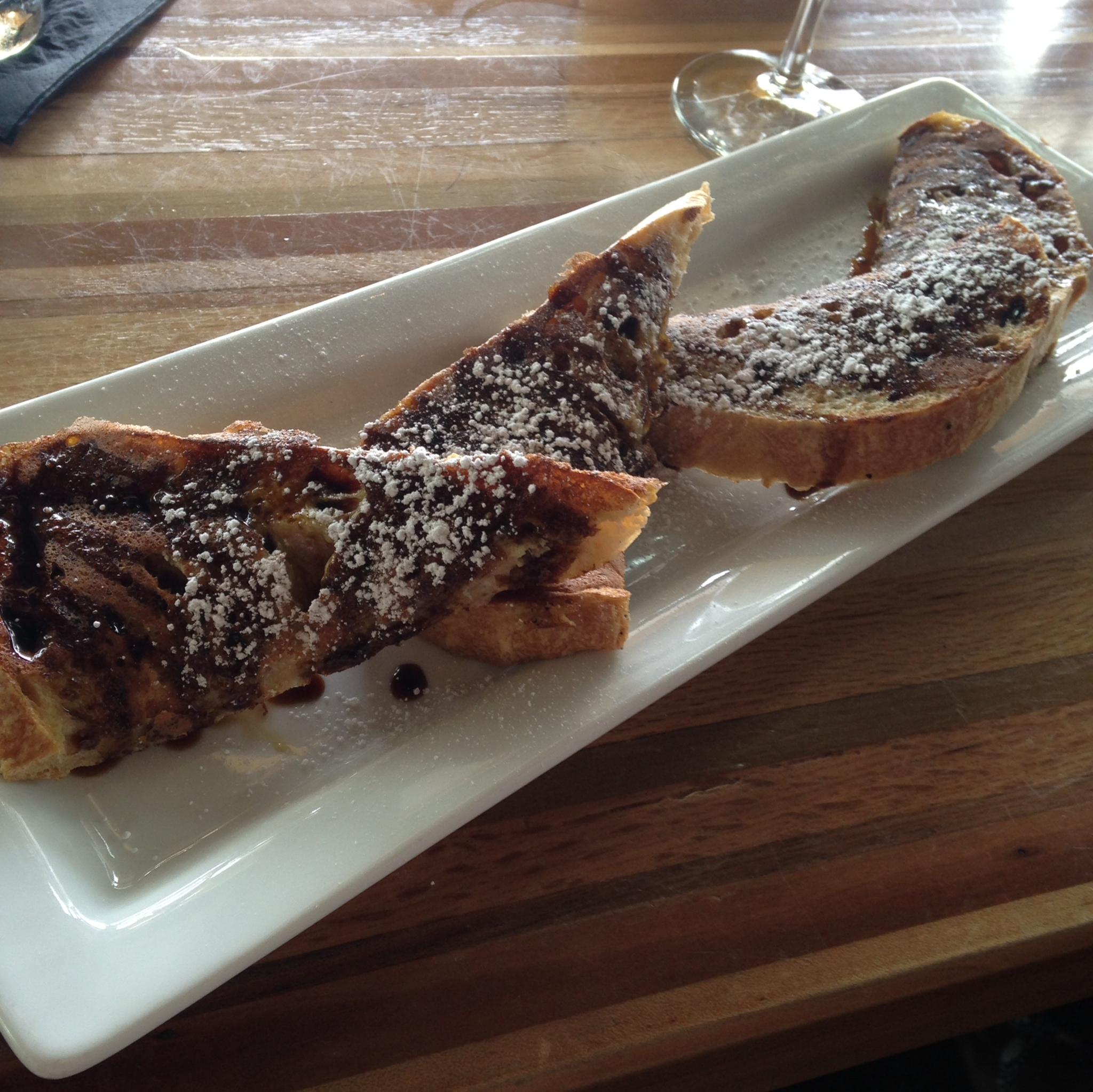 French Toast - The Flying Squirrel - Niedlov's sourdough, orange molasses, powdered sugar.