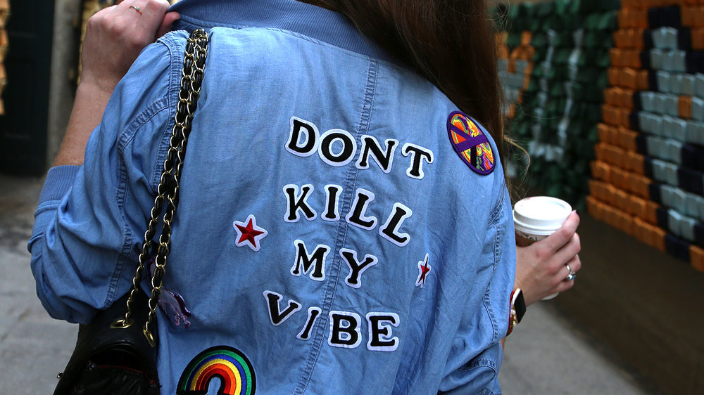 My styling of a denim bomber jacket with patches over a fun black skirt and feminine top - always with a latte in hand, of course.