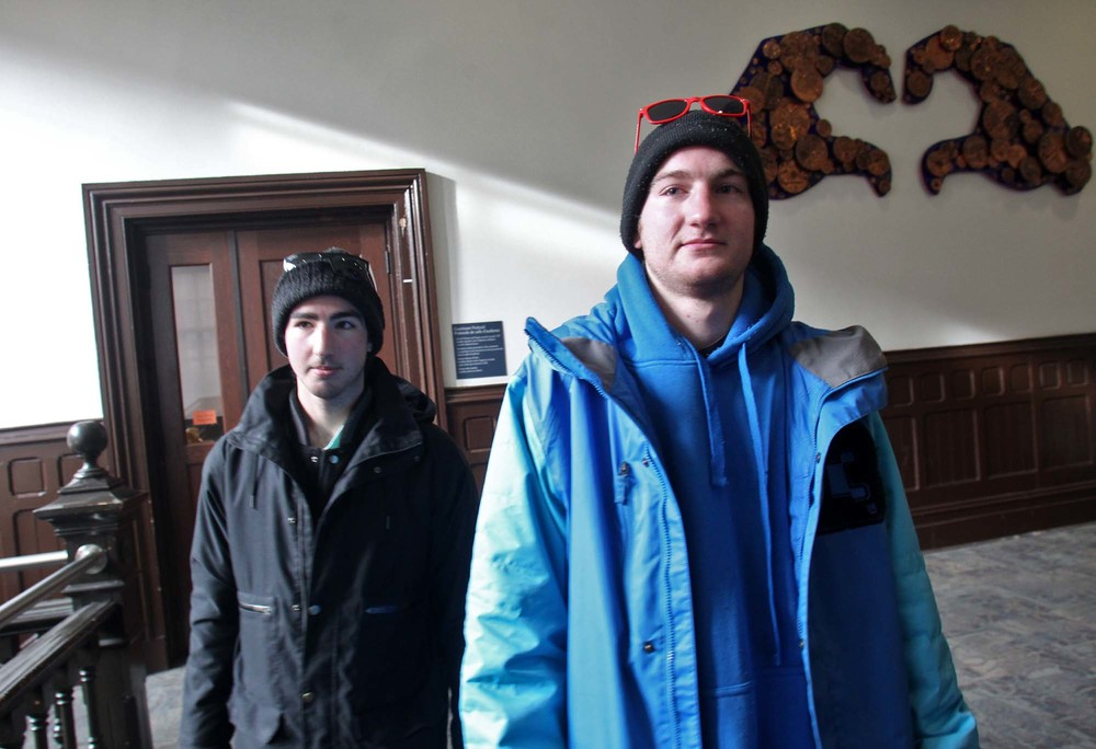 Bailey, left, and Damien Roy head into a courtroom at Halifax provincial court  Feb. 3. (TIM KROCHAK / Local Xpress)