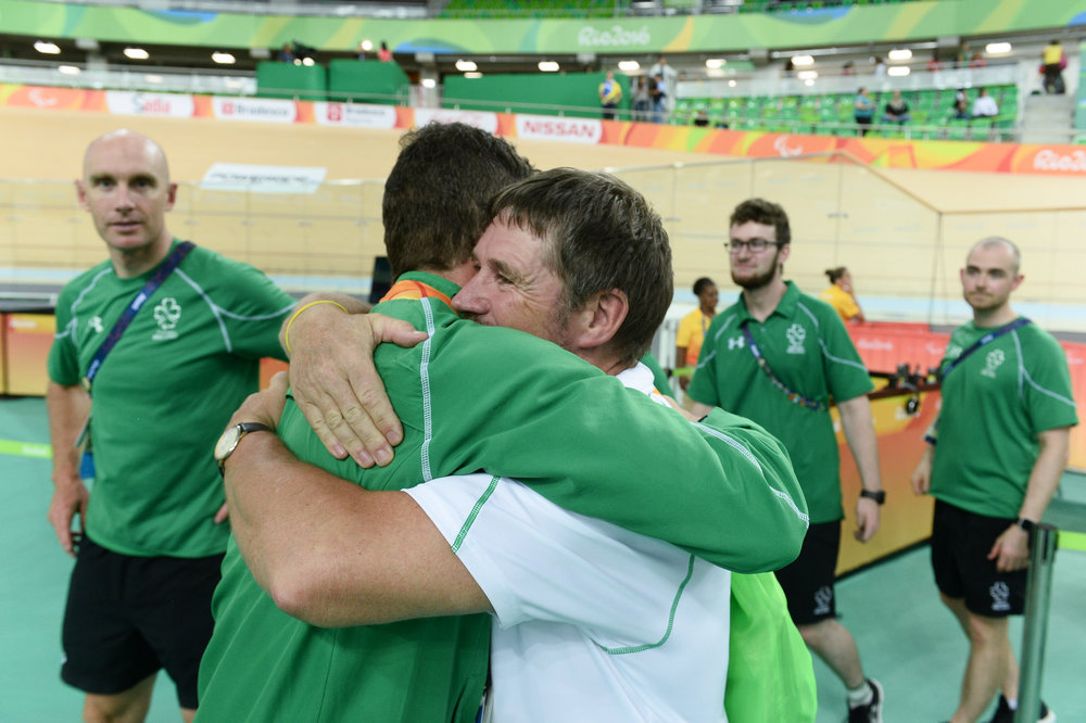 Cycling: Eoghan Clifford celebrates with Chef de Mission Denis Toomey