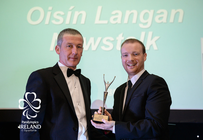 Oisín Langan, right, of Newstalk, accepts the award for Best Paralympic Games Radio Coverage, from Cecil Ryan, OCS Europe, at the OCS Irish Paralympic Awards