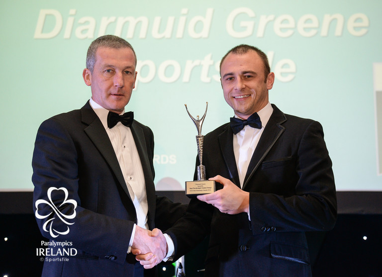Diarmuid Greene, right, of Sportsfile, accepts the prize for Best Paralympic Games Image, from Cecil Ryan, OCS Europe, at the OCS Irish Paralympic Awards