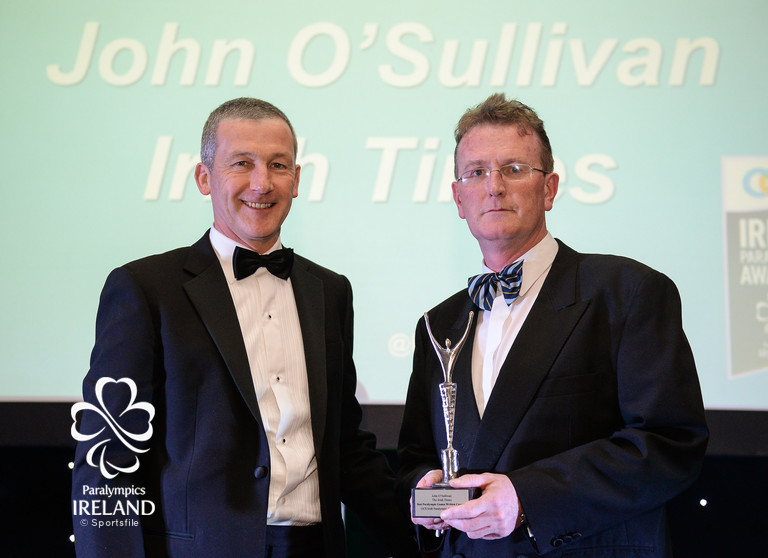 John O'Sullivan, right, of Irish Times, accepts the prize for Best Paralympic Games Written Coverage, from Cecil Ryan, OCS Europe, at the OCS Irish Paralympic Awards