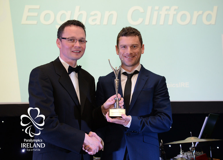 Eoghan Clifford, from Galway, accepts the prize for Outstanding Male Performance, from Minister of State for Tourism and Sport Patrick O'Donovan T.D., at the OCS Irish Paralympic Awards