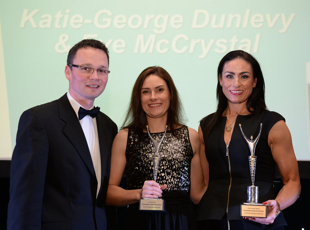 Katie-George Dunlevy, centre, and Eve McCrystal, accept their prize for Outstanding Female Performance, from Minister of State for Tourism and Sport Patrick O'Donovan T.D., at the OCS Irish Paralympic Awards