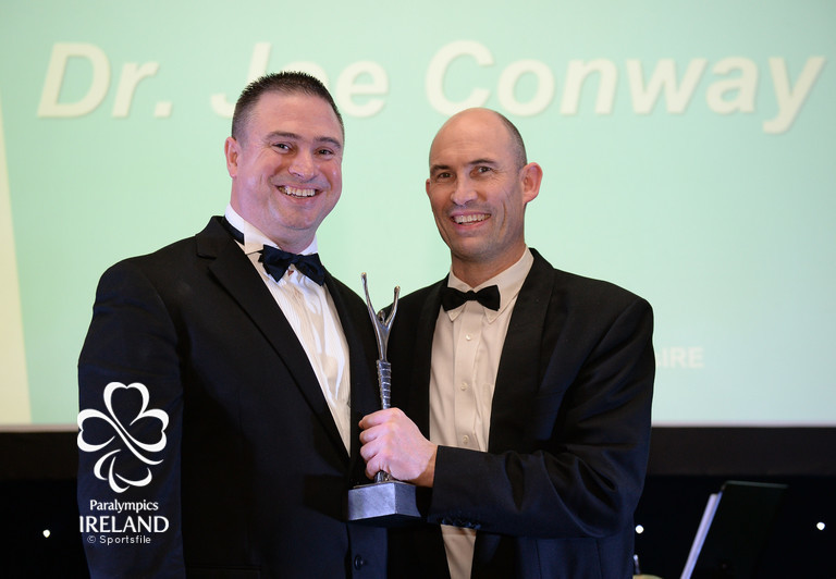 Dr. Joe Conway accepts the prize for Outstanding Team Member (Non Athlete), from Dave Malone, Irish Paralympic Performance Director, at the OCS Irish Paralympic Awards