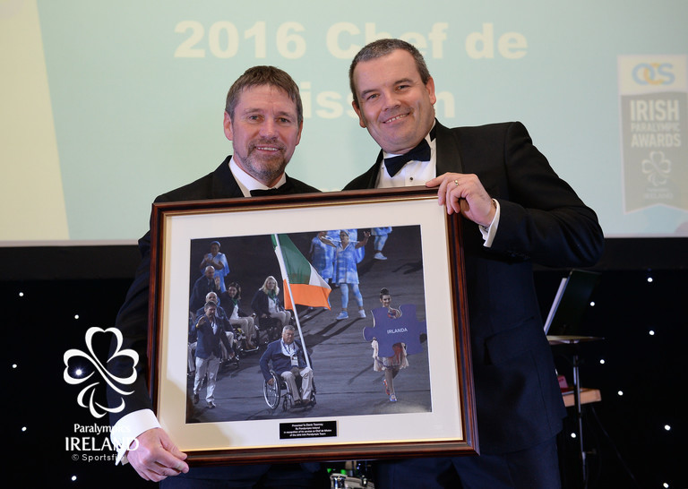 2016 Chef de Mission Denis Toomey, left, is honoured with a framed photograph by Liam Harbison, CEO Paralympics Ireland, at the OCS Irish Paralympic Awards