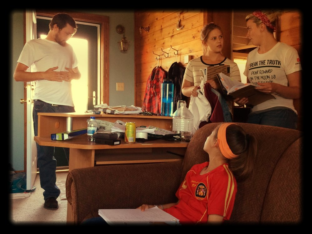 "Mallory in the couch going over her lines, while Art Director Aby and I discuss a scene. The shirt I'm wearing is from our Production Manager Makenzie Boettcher. It reads ""Speak the Truth: Dear Coward on the Moon is going to kick ass."" Best gift."