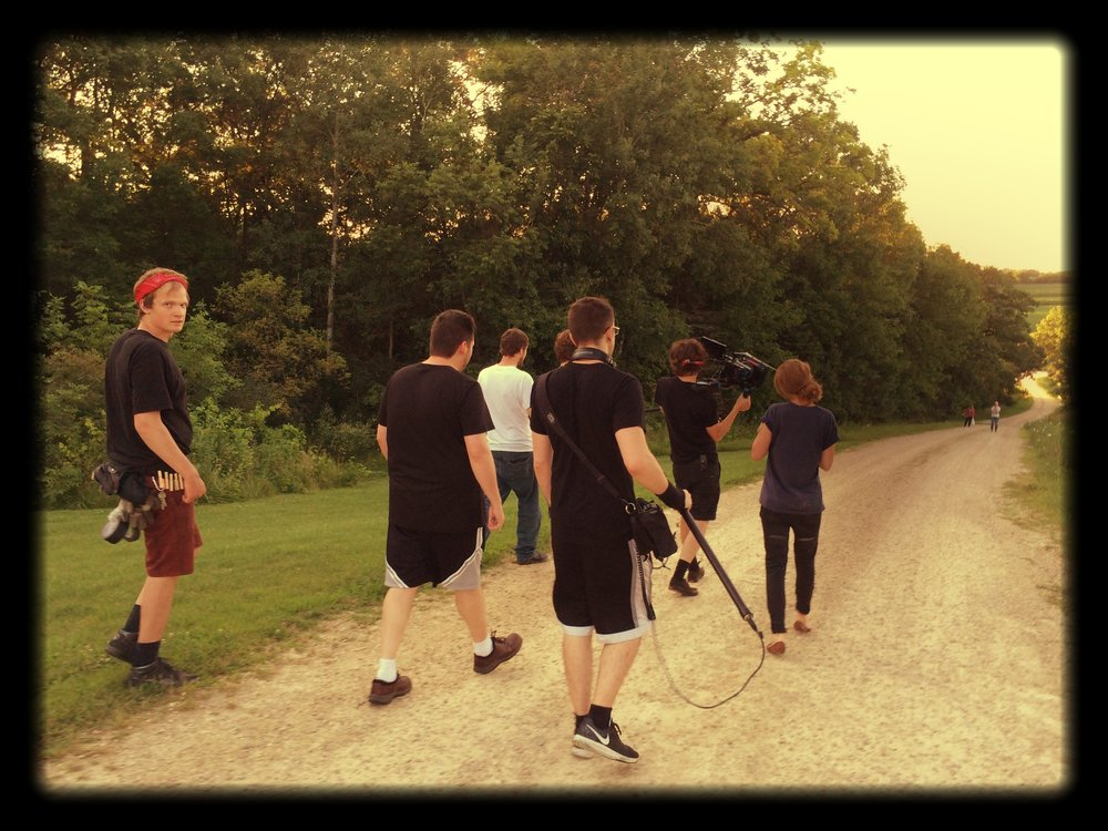 Everyone walking behind Logan and Ryan our camera and sound guys as we shoot the last outdoor shot with Ashley. It was a special occasion and they all wanted to be a part of the final exterior shot. So when you see the final outdoor shot in the film, know that there are this many people behind the camera trying to be quiet.