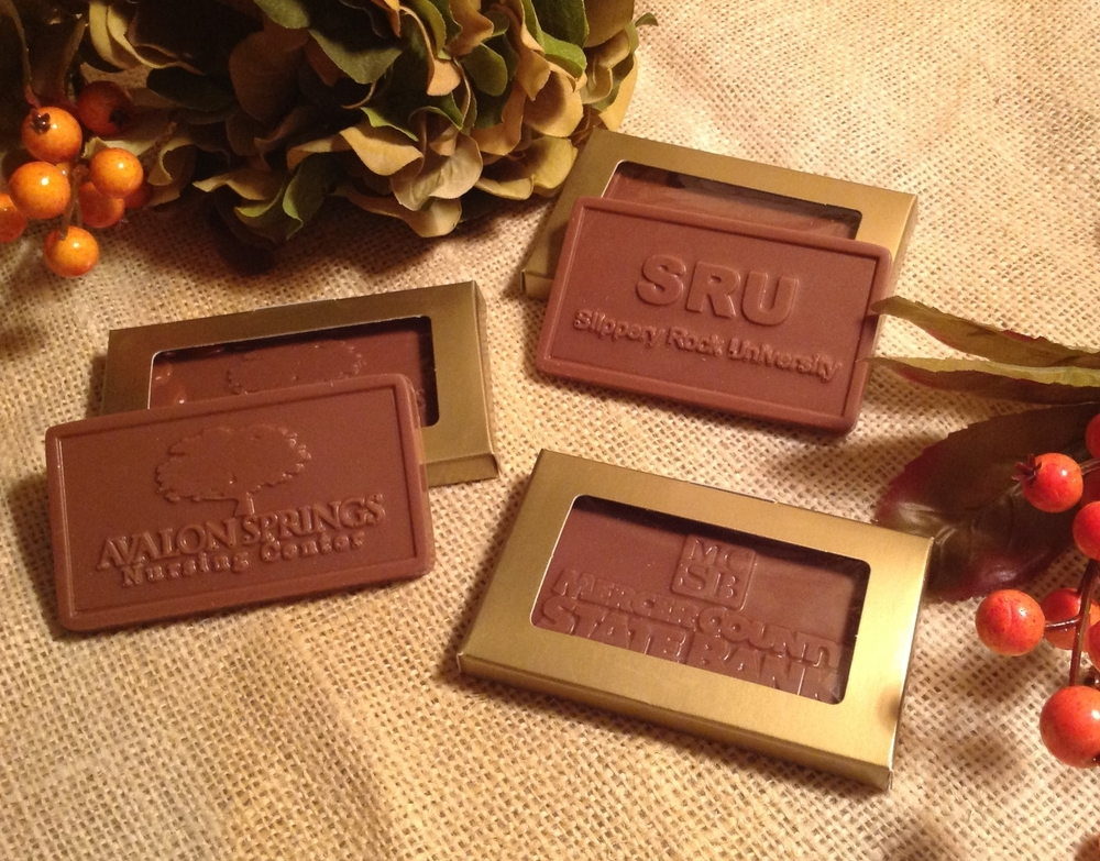 1 oz. solid chocolate card with your business name or logo.