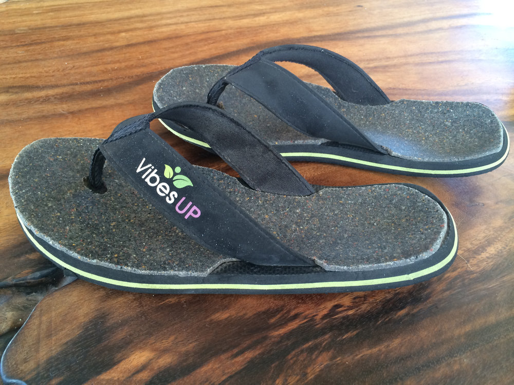 Above pic is of Kaitlyn's personal pair of Earth Flip Flops after wearing for 3-4 months. The bottom layer s designed in time to conform to the natural curve of our foot. It is normal for the words on the bottom to wear after 2-6 months. Which will not in any way affect the operation of your Flip Flops.
