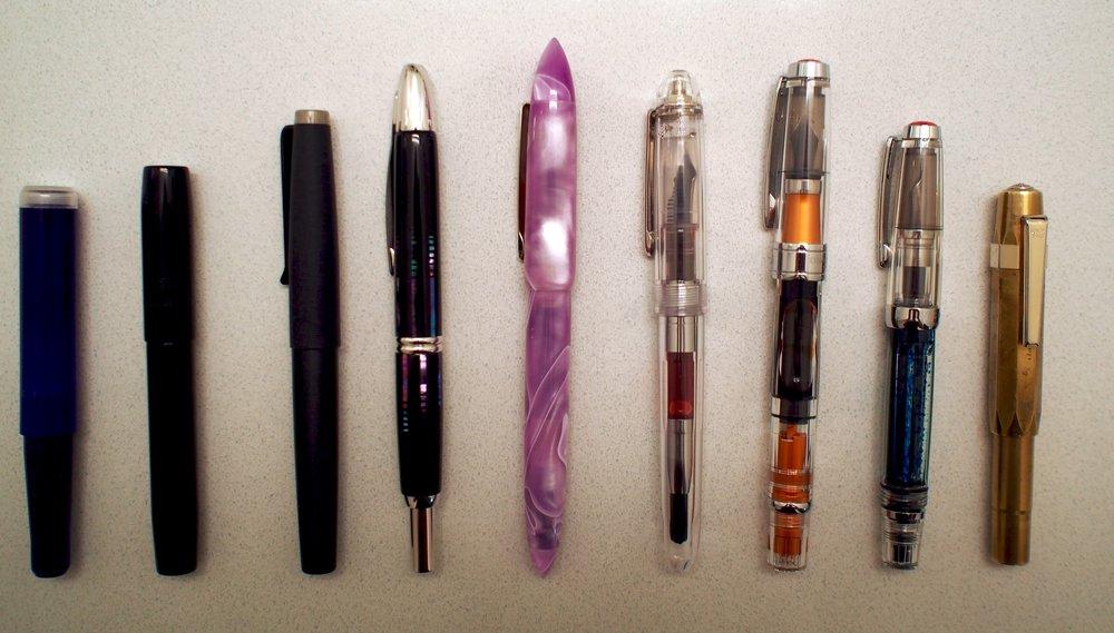 From right:FC Pocket 40, FC45, Tactile Turn Gist, Pilot Vanishing Point, Edison Nouveau Premiere Lilac, Platinum 3776 Century Sai, TWSBI 580, TWSBI Vac Mini and Kaweco Brass Sport
