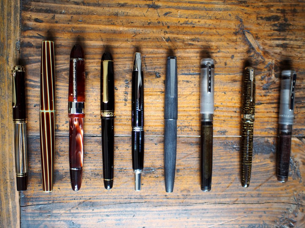 L-R:  Pelikan M400, Nakaya Decapod Twist, Bexley Gaston's Special Reserve, Platinum 3776 Century, Pilot Vanishing Point, Lamy 2000, Franklin-Christoph Model 20, Parker Vacumatic Major Golden Pearl, Franklin-Christoph Pocket 20