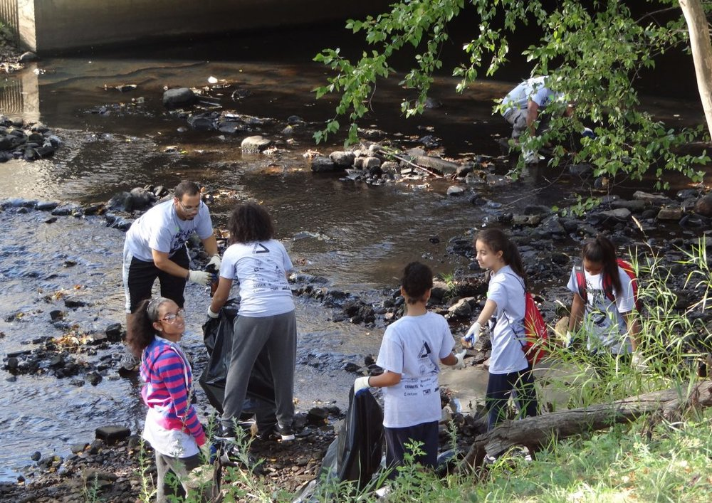 Lawrence, Massachusetts youth clean up their local waterways as part of the Groundwork Lawrence Spicket River Cleanup 2015.