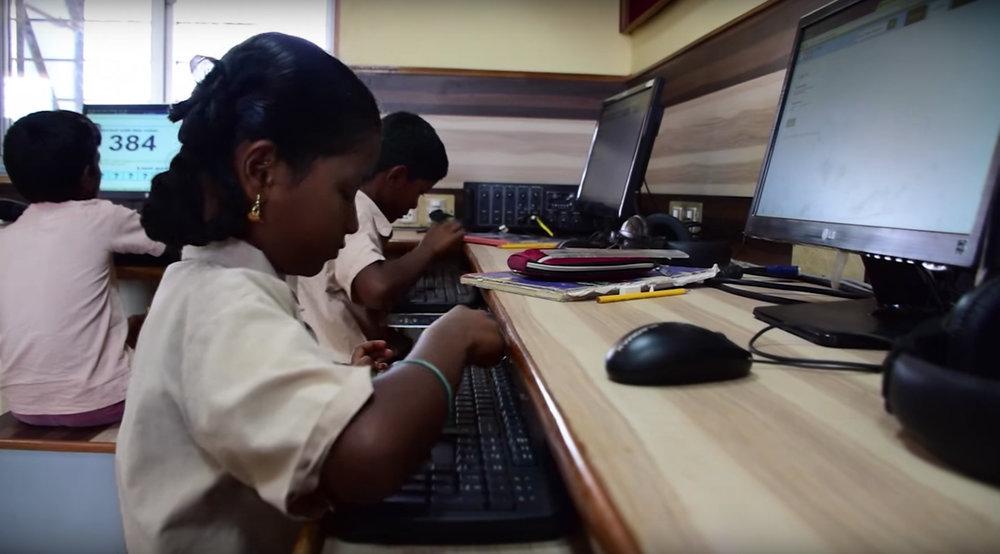 Students at the Panchayat Union Middle school (Pudukkadu, Coimbatore) learning math using Khan Academy modules.