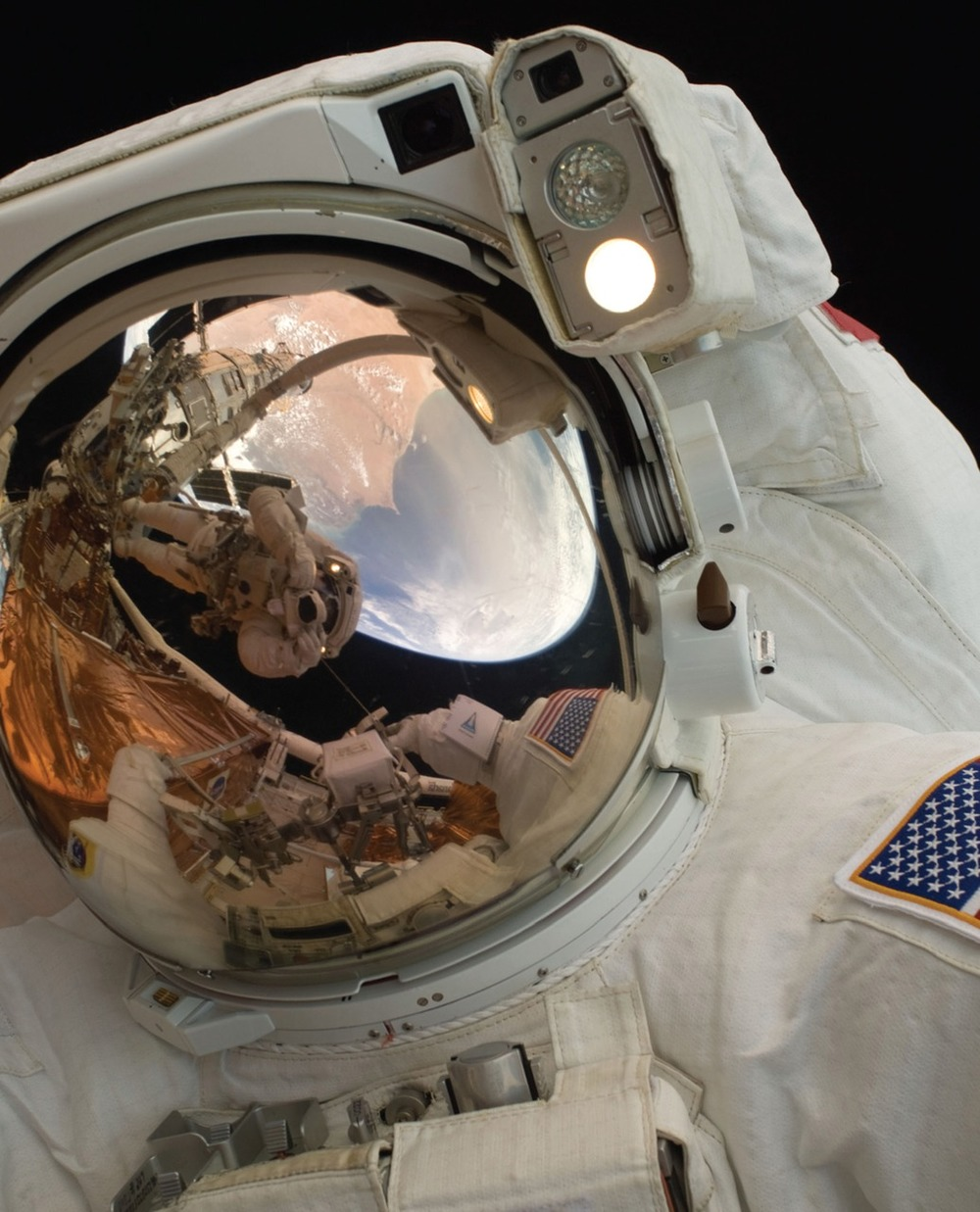 A close-up of Astronaut John Grunsfeld shows the reflection of Astronaut Andrew Feustel, perched on the robotic arm and taking the photo. The pair teamed together on three of the five spacewalks during Servicing Mission 4 in May 2009.   The Hubble Space Telescope is a project of international cooperation between NASA and the European Space Agency. NASA's Goddard Space Flight Center manages the telescope. The Space Telescope Science Institute conducts Hubble science operations.   Goddard is responsible for HST project management, including mission and science operations, servicing missions, and all associated development activities.   To learn more about the Hubble Space Telescope go here:   www.nasa.gov/mission_pages/hubble/main/index.html      Some absolutely mesmerising images from the Hubble Space Station on  NASA's Goddard Flight Centre's Flickrstream .
