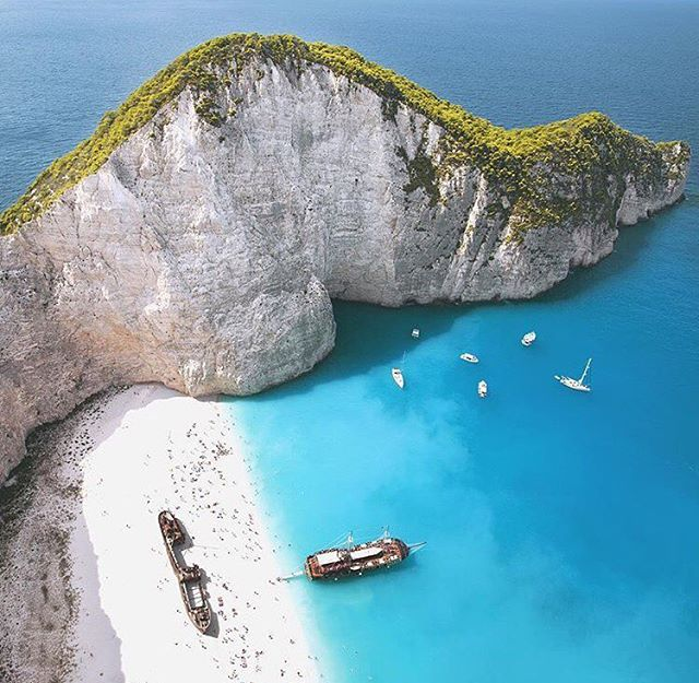 Who wouldn't want to be on a beach with white sand and blue water? The Navagio Beach even has a shipwreck onshore to explore. #adventure #ctg #bluebeach #navagiobeach #green #ctgroups #shipwreck #greenmountain #bluewater #bestview #topdestinations #christiantravelgroups #instapic #photoftheday #travelgram #ilovegreece #happyplaces