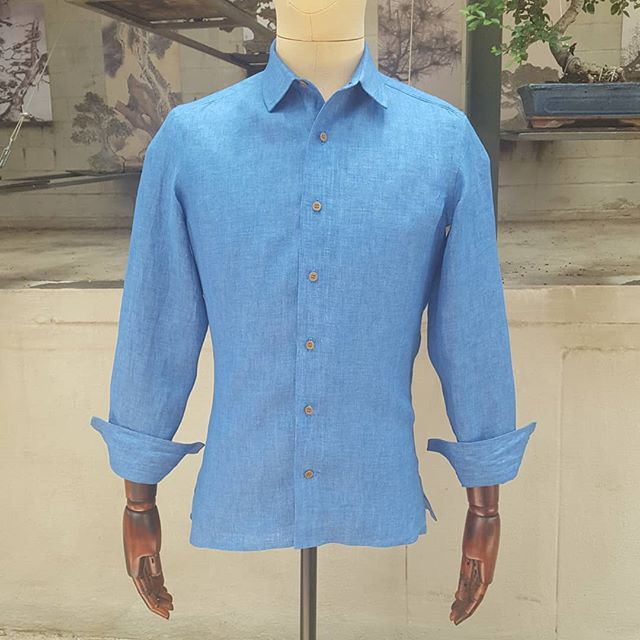 This shirt has been on the mannequin for a week waiting for its owner to come collect it, and it has attracted a lot of attention. I think the vibrant blue color of the linen paired with the soft brown of the corozo buttons catches the eye. It makes a stylish casual summer shirt!