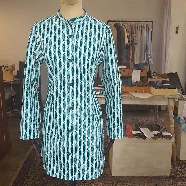 This is another unique custom piece that we recently finished. This client was inspired by a kaftan we had made for someone else. She liked the deep side slits with a self-faced hem; however, she wanted a more jacket-like feel with a banded collar, larger buttons spaced further apart, and no cuffs on the sleeves. The result can be worn as a tunic on its own or as a light jacket. It is made from a beautiful wax-print fabric made by @vlisco.