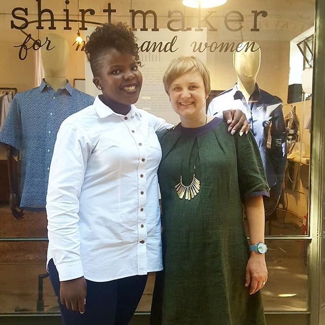 We celebrated Mpumi's first anniversary with five8ths this week. To celebrate the occasion, she wore her custom white Oxford five8ths shirt that she sewed as part of her training. Mpumi joined us in 2017 after completing her studies in Fashion Design at the University of Johannesburg. Over this past year, Mpumi has grown tremendously. She has become quite confident in her abilities, and has mastered the skills necessary to sew a shirt to the standards of five8ths. She is an invaluable member of the team because of her fierce commitment to meeting any goal or deadline that is set. She organizes each day around the tasks that need to get done, both immediately and over the longer term. It is quite impressive to see! She is also the member of our team that makes us laugh the most. She's got a big personality and is always ready to entertain us when we need it. We are lucky to have her as a part of the team, and we want to congratulate her on her first anniversary with five8ths! We look forward to many more.