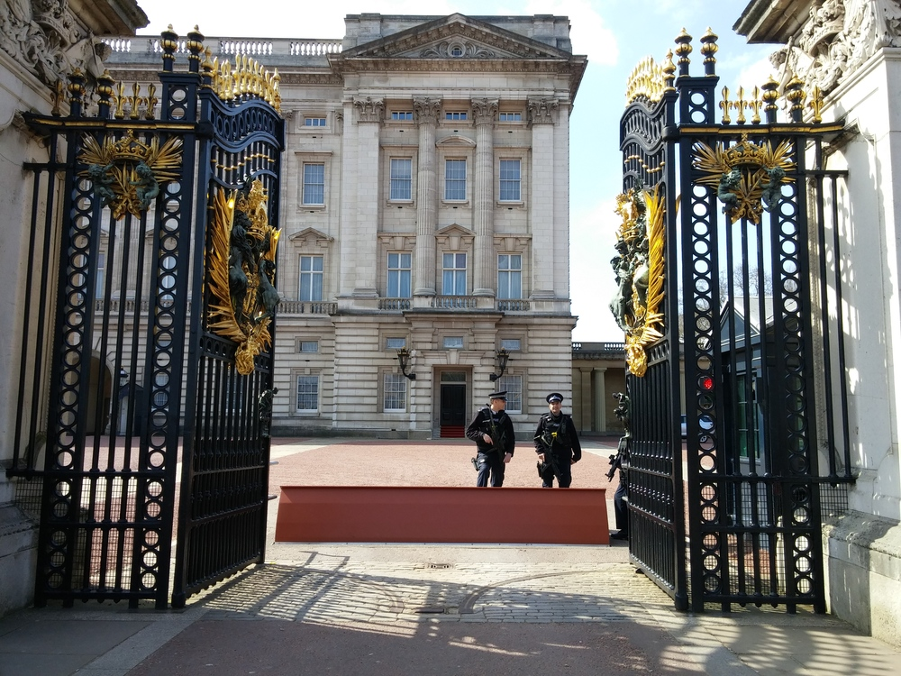 Two friendly guards stand watch at Buckingham Palace.