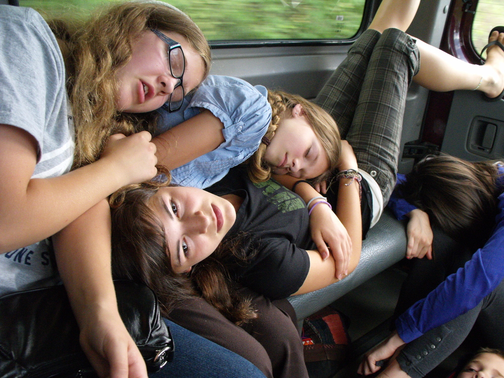 The seatbelt-less vans and the winding mountain roads called for creative solutions for the sleepy travelers.