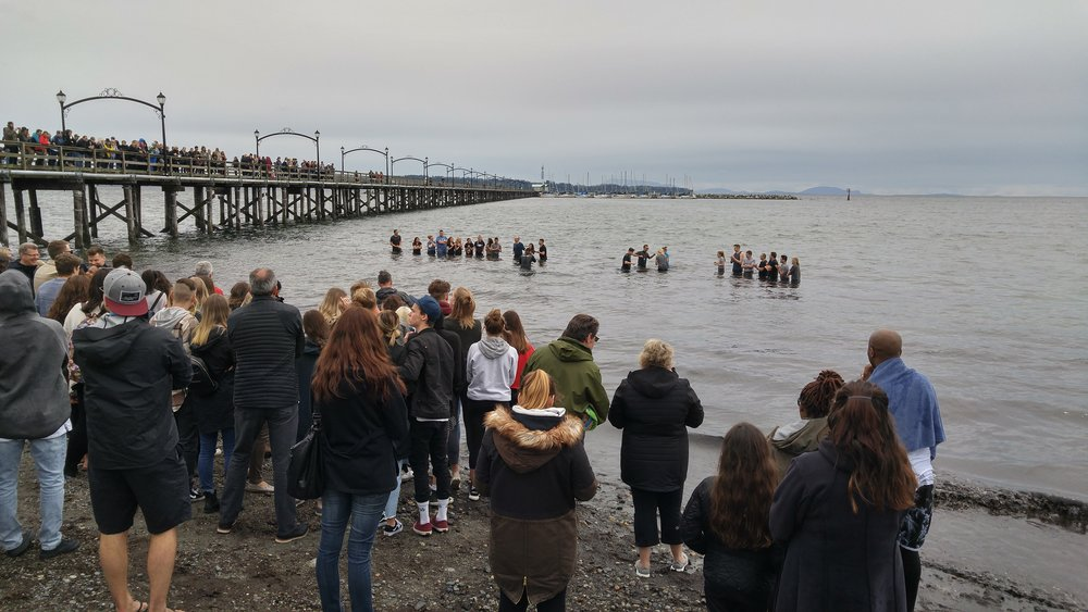 The Village Church held a baptismal service out at the White Rock pier one windy Sunday morning after Easter. At least 60 people made the wonderful decision that morning to declare their allegiance to Christ!