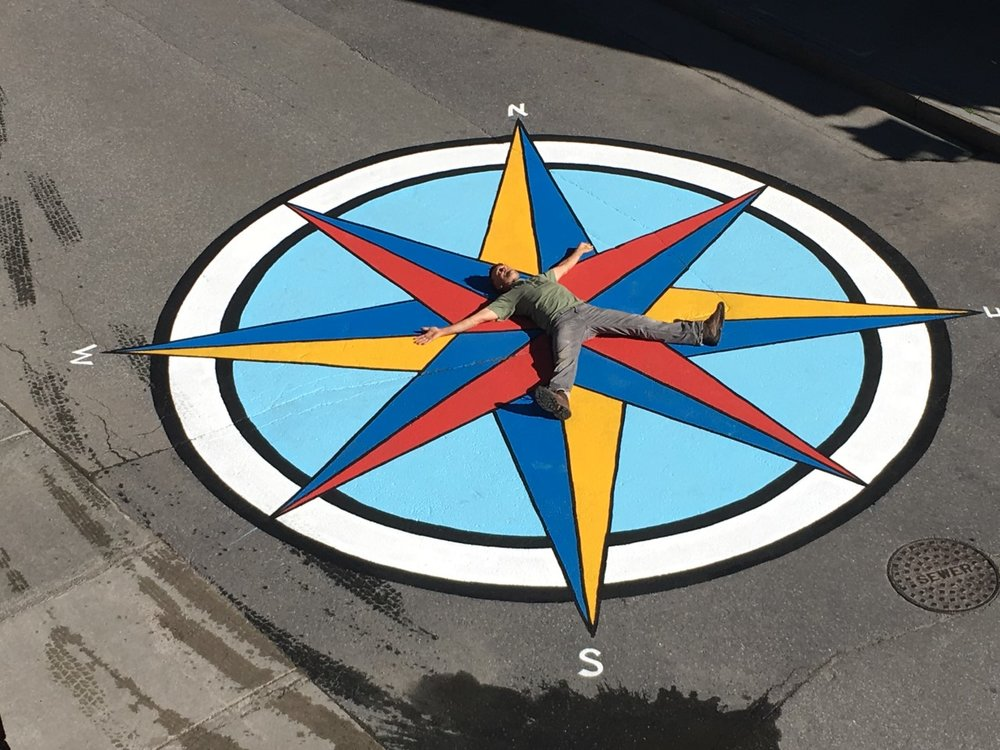 Compass: design and painting by LSA Steering Committee with help from several early morning assistants. Thanks to Tom McArdle for letting this happen on the street!