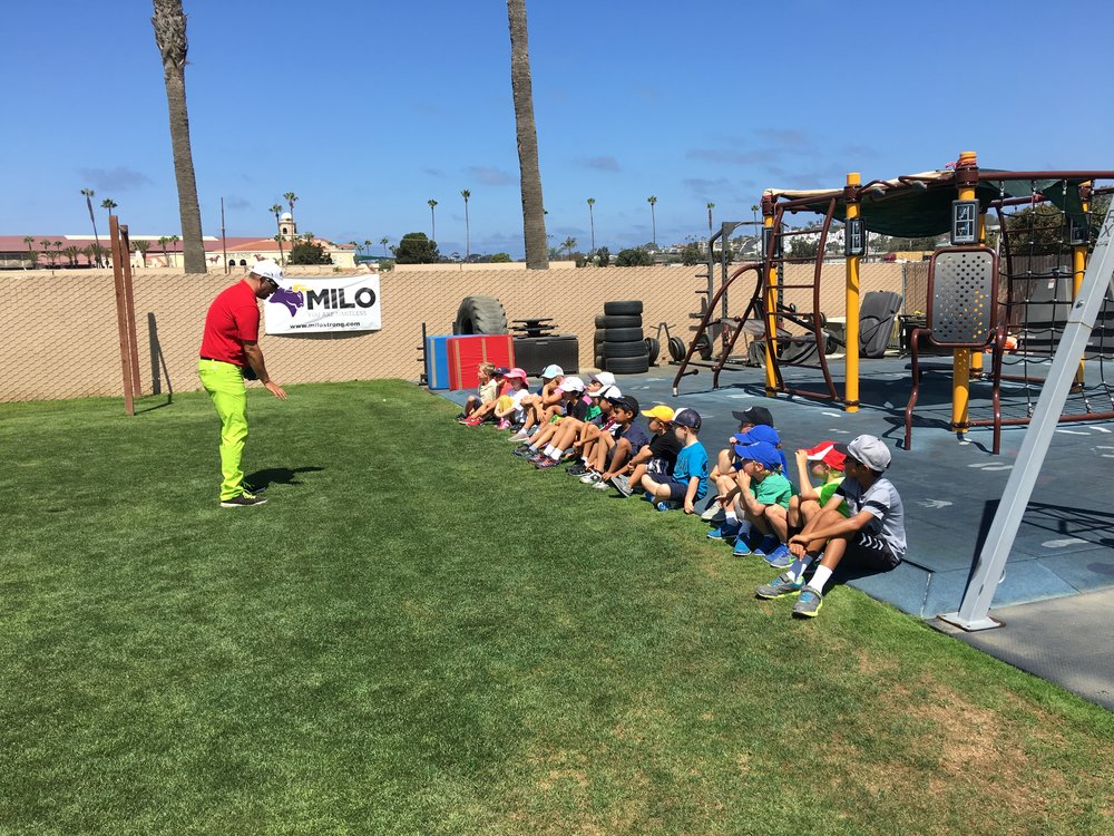 Coach Matt taking time to discuss grip and alignment with a group of young athletes. The programming we use at The Academy at Del Mar Golf Center is consistent and deliberate. To create an atmosphere conducive to learning and exploring, the same message must permeate the team and be used by all team members.