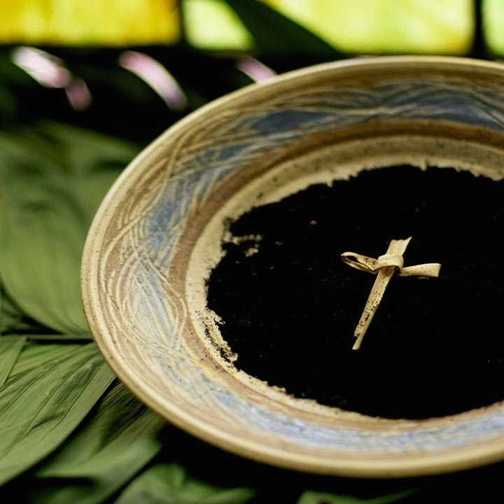 Ashes in bowl on palm leaves.square.jpg