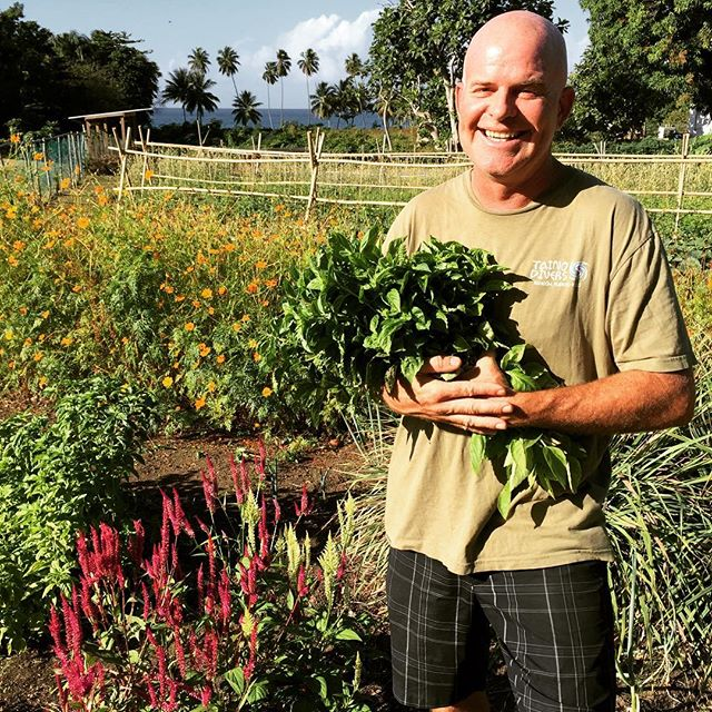 Sharing the bounty with our neighbors. Steve-O may look like a bridesmaid, but he is actually holding a bouquet of basil from our garden that will soon be pesto at The Shipwreck. Go get some.