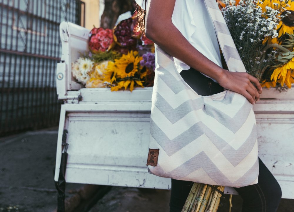 SHOP OUR HOBO - The one that began it all. Our hobo is our classic, the first pattern we ever made and continues to shape all of our designs that have followed. It's the perfect mid-sized bag and an overall crowd-pleaser when it comes to practicality and style.