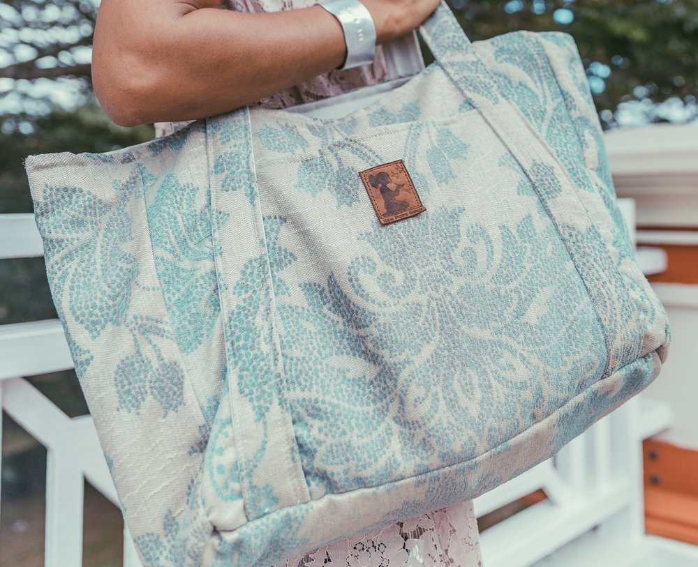 SHOP OUR TOTE - This one's for all the busy students, the working girls, and all those that carry the world on their shoulders. We set out to design a bag that would hold it all and that is just what our tote does. Our prints come alive on our bag with the largest surface-area to date.