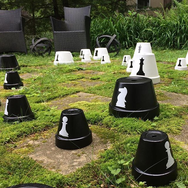 Happy #ThrowbackThursday! Today I would like to share an update on one of my summer projects...the outdoor Chess Board! I spray painted the terracotta pots black and white, then labeled them with the help of my #SilhouetteCameo. They add such a unique touch to our yard! #yardgames -Kathy Inspire yourself and others today www.TUliving.com/blog