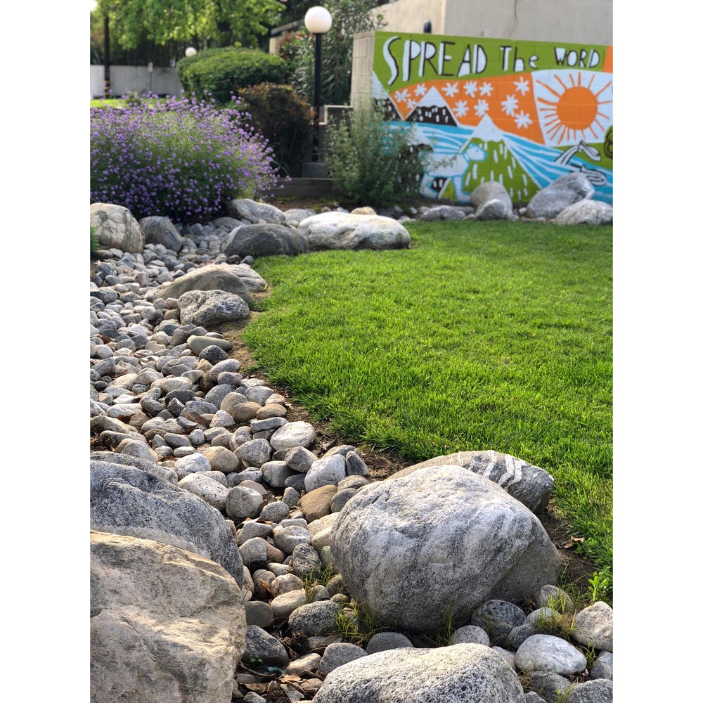 The South Pasadena Community Garden, designed by Daniel Abratte, includes two vibrant murals, a little lending library, a river rock swale and various seating areas.