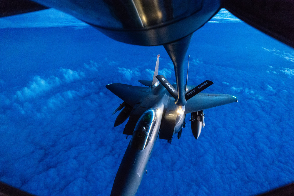 A U.S. Air Force F-15 Strike Eagle approaches to refuel from a 340th Expeditionary Air Refueling Squadron KC-135 Stratotanker over Iraq, Dec. 1, 2016.jpg