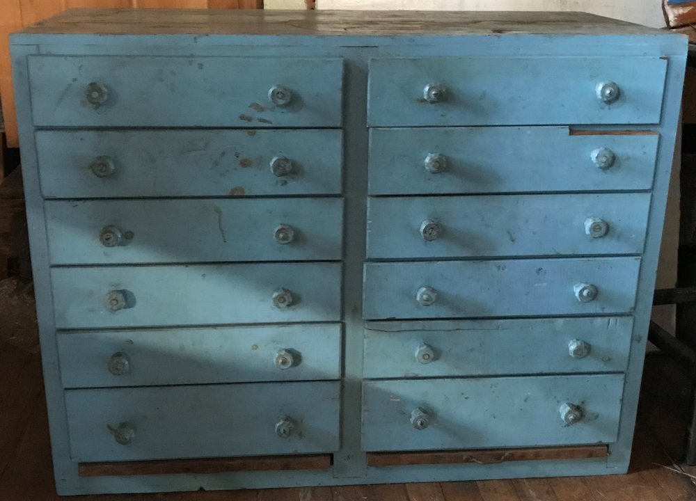 Antique 12 drawer storage cabinet