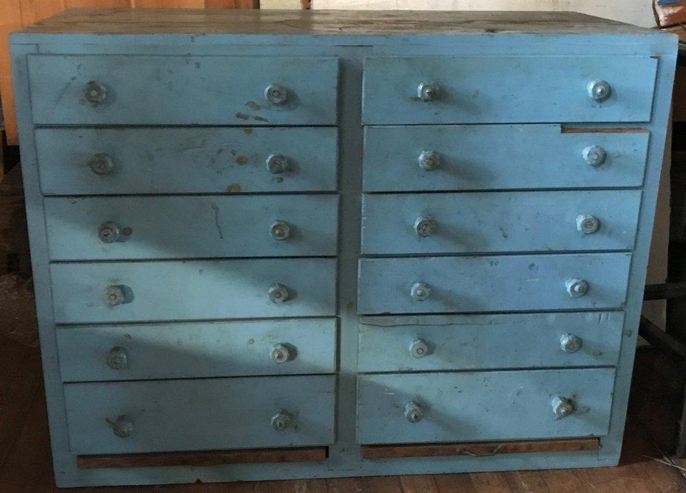 Antique 12 drawer storage cabinet