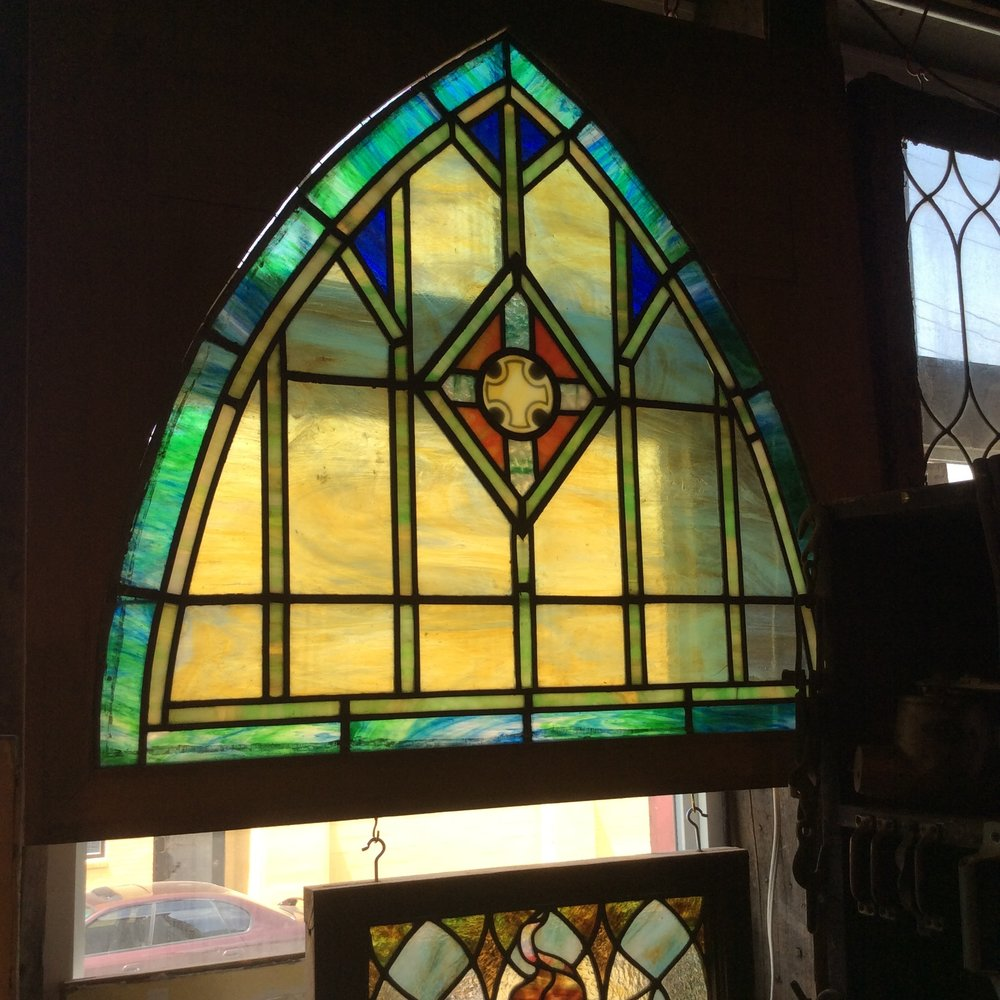English Ecclesiastical Arched stained glass window.