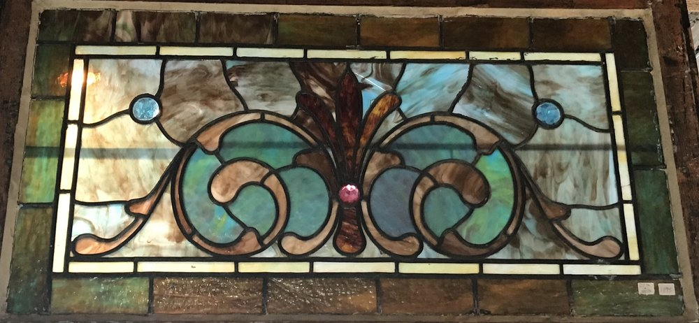 Antique Jeweled stained glass window.