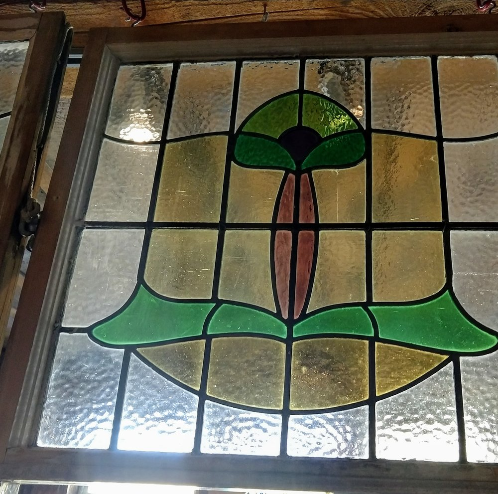 Pair of Smaller English stained glass windows.