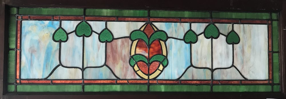 Antique slag glass transom window