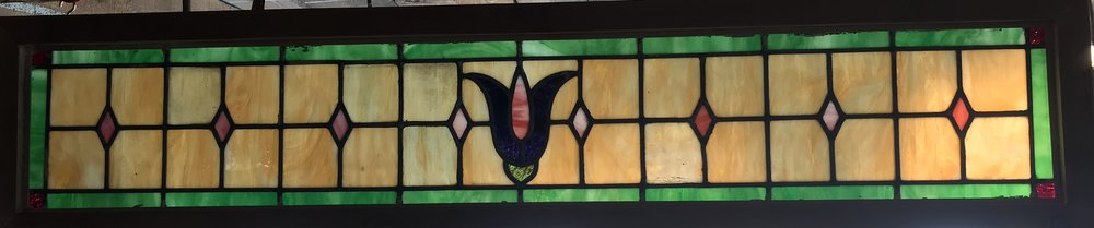 Slag glass transom window