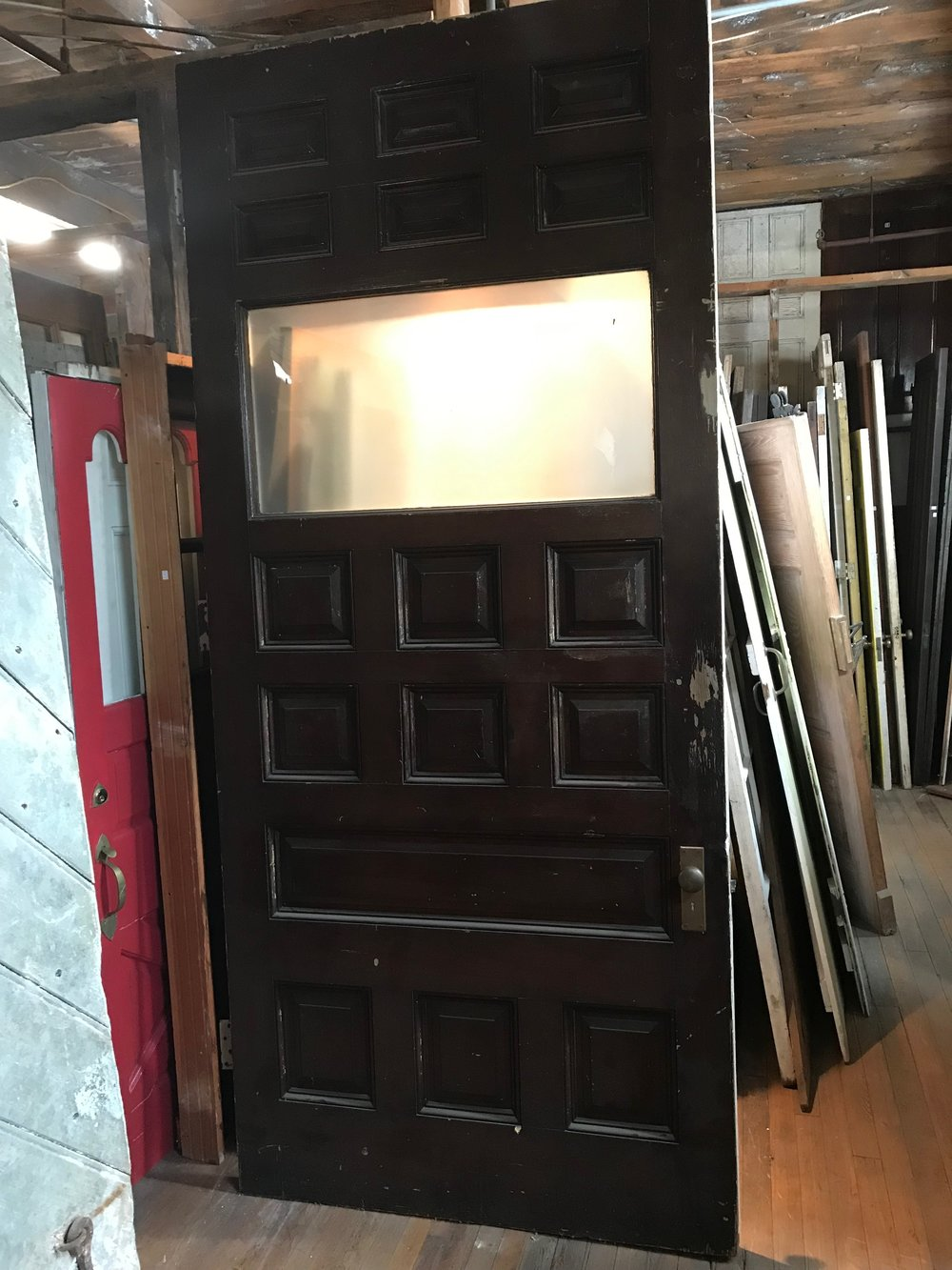 Oversized antique paneled entry door