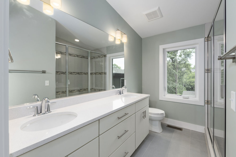 Master Bathroom with Quartz Double Vanity and Walk-In Shower.jpg