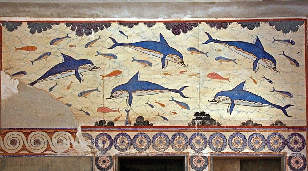 """Fresco of the Dolphins"" in Knossos Palace, Crete, Greece. 1800-1400 b.c.   This fresco is a fabulous example of early Minoan Painting, very interesting for its precise representation of the natural world without any human presence. Located in the Bath Hall -where such aquatic motifs were very suitable-, the ""Fresco of the Dolphins"" is an authentic masterpiece, for its undeniable decorative value and for its remarkable effect of movement.  The restoration of the frescoes in the Knossos Palace at the beginning of the last century received criticism for the bright colors employed, yet the final result is probably close to the original aspect of the paintings, created at the heart of the Minoan splendor.  More about the Bronze Age palace of Knossos:  https://en.wikipedia.org/wiki/Knossos"